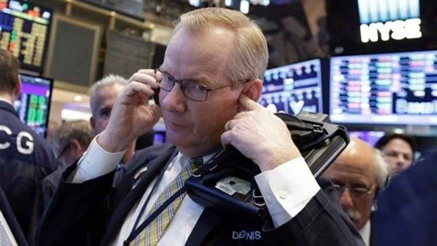 Trader Dennis Maguire works on the floor of the New York Stock Exchange, Thursday, Aug. 13, 2015. Global stocks are steadying as the decline in China's currency slowed and the country's central bank tried to ease fears of more big declines. (AP Photo/Richard Drew)