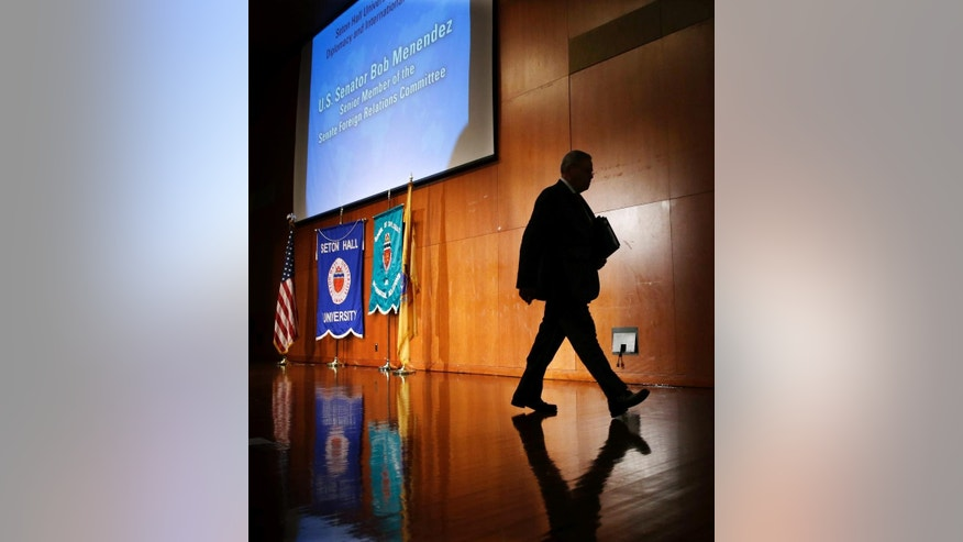 Sen. Bob Menendez walks off stage after addressing a gathering at Seton Hall University, Tuesday, Aug. 18, 2015, in South Orange, N.J. Menendez announced on Tuesday his opposition to the Iran nuclear deal, the second Democratic senator to go against President Barack Obama, who is heavily lobbying for a congressional endorsement of the agreement. Menendez, a senior member of the Senate Foreign Relations Committee, joins Sen. Chuck Schumer of New York in rejecting the deal. (AP Photo/Mel Evans)