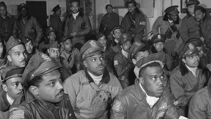 Several Tuskegee airmen attending a briefing in Ramitelli, Italy in March 1945.