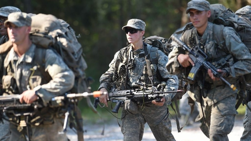 In this photo taken on Aug. 4, 2015, a female Army Ranger marches with her unit during Ranger School at Camp Rudder on Eglin Air Force Base, in Fla.  According to the Northwest Florida Daily News, she and one other female were the first to complete Ranger training and earn their Ranger tab this week. (Nick Tomecek/Northwest Florida Daily News via AP) MANDATORY CREDIT