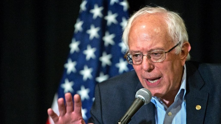 U.S. Sen. Bernie Sanders defines his opinion during a press conference following a speech at the 59th annual Nevada State AFL-CIO Constitutional Convention at the Luxor Hotel & Casino on Tuesday, Aug. 18, 2015, in Las Vegas.  (LE Baskow /Las Vegas Sun via AP) LAS VEGAS REVIEW-JOURNAL OUT; MANDATORY CREDIT