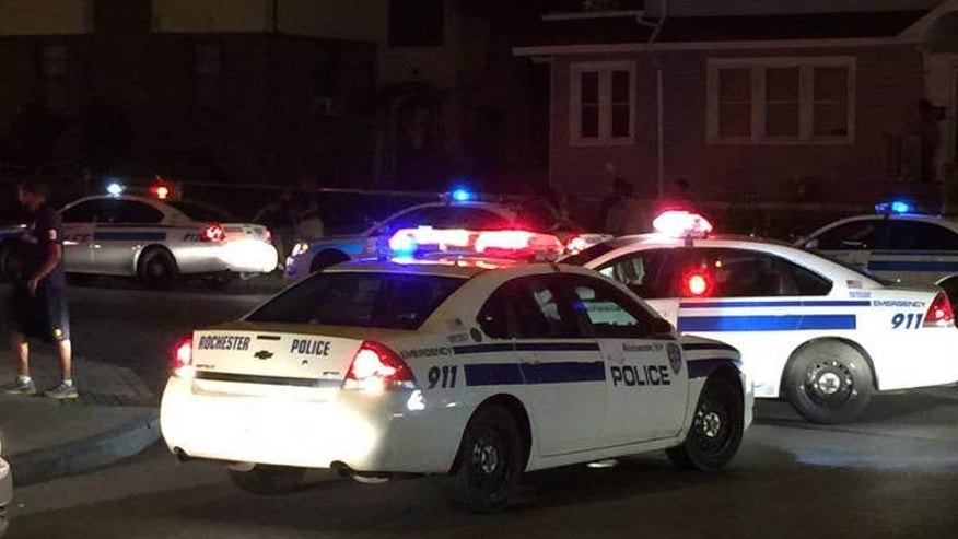 Aug. 19, 2015: In this photo provided by WHEC-TV, police vehicles block off the street after official said a fatal shooting occurred in Rochester, N.Y.
