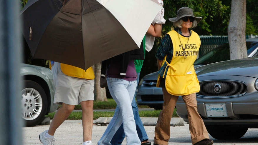 Sept. 14, 2009:  Women are concealed from view by Planned Parenthood volunteers as they enter the Planned Parenthood of Collier County in Naples, Fla.