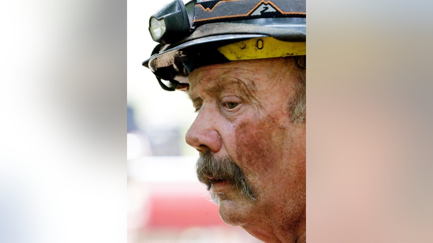 "Firefighter Mark Groves, who said he was 32 hours into fighting fire, takes a breather Thursday, Aug. 20, 2015, in Twisp, Wash., a day after three firefighters were killed fighting a wildfire near the town. Authorities say three firefighters died after their vehicle crashed and was apparently caught by a ""hellstorm"" of flames as they battled a blaze in Washington state. (AP Photo/Elaine Thompson)"