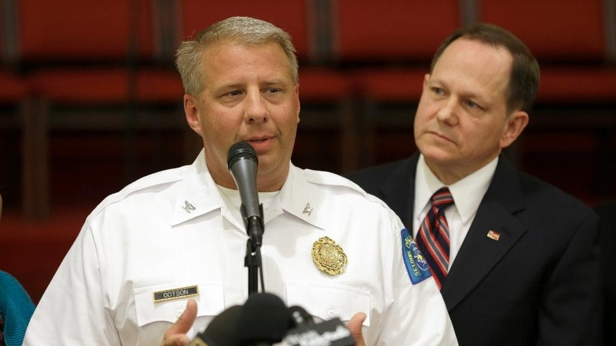 St. Louis police chief Sam Dotson, left, appeals for calm alongside mayor Francis Slay, Thursday, Aug. 20, 2015, West Side Missionary Baptist Church in St. Louis. Officers made several arrests and deployed tear gas amid protests in St. Louis following the death of a black 18-year-old who was fatally shot by police Wednesday after he allegedly pointed a gun at them while attempting to serving a search warrant in a crime-troubled section of the city's north side. (AP Photo/Jeff Roberson)