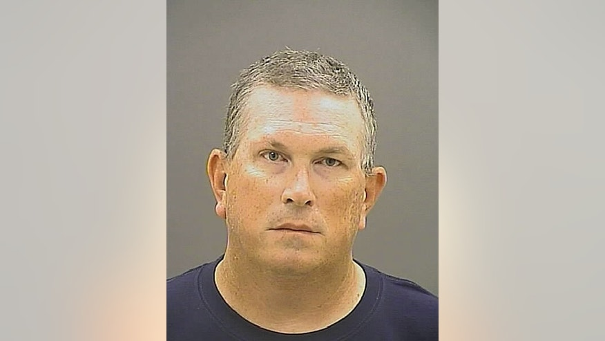 This photo provided by Baltimore Police shows Wesley Cagle. Cagle, a Baltimore police officer who authorities say shot a burglary suspect in the groin at close range after he'd been subdued is being charged with attempted first- and second-degree murder, the city's top prosecutor announced Wednesday, Aug. 19, 2015.  (Baltimore Police via AP)