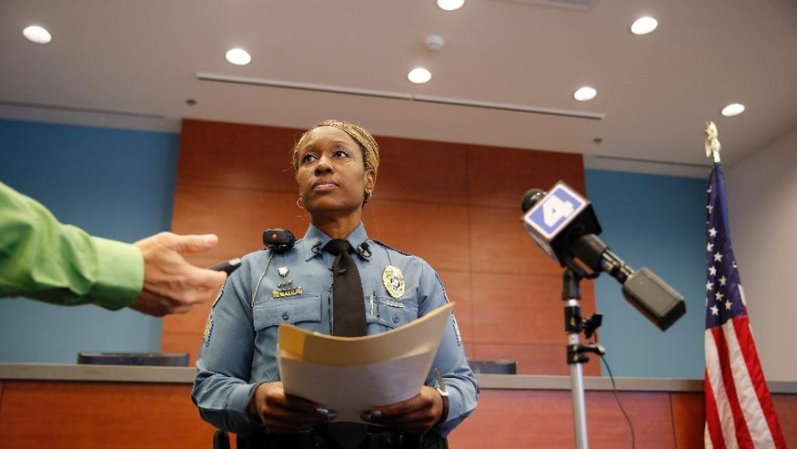 Ferguson police Sgt. Dominica Fuller speaks during a news conference Thursday, Aug. 20, 2015, in Ferguson, Mo. Fuller gave an update on the investigation into a shooting that left a 9-year-old girl dead and her mother injured after someone fired shots into their home Tuesday in Ferguson. (AP Photo/Jeff Roberson)