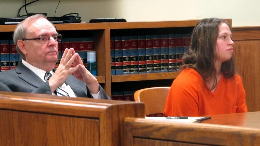 Brittany Pilkington, right, listens as a judge sets a $1 million bond in the case in which Pilkington is accused of suffocating her three sons over 13 months, with her attorney, Marc Triplett, beside her, on Thursday, Aug. 20, 2015, in Bellefontaine, Ohio. (AP Photo/Andrew Welsh-Huggins)