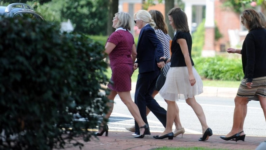 Molly Shattuck, second from left, is escorted from the Sussex County Courthouse in Georgetown, Del., Friday, Aug. 21, 2015. Former Baltimore Ravens cheerleader Molly Shattuck was sentenced to two years of probation after pleading guilty to raping a 15-year-old boy at a vacation rental home in Delaware.    (Kim Hairston/The Baltimore Sun via AP)  WASHINGTON EXAMINER OUT; MANDATORY CREDIT