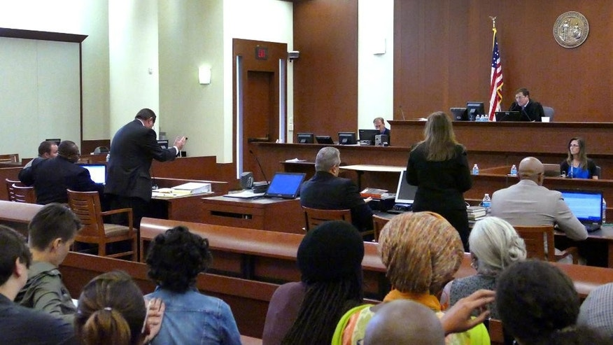 Superior Court Judge Robert Ervin,rear right,talks with attorneys from both sides after the jury said that they were deadlocked during the fourth day of deliberations in Charlotte-Mecklenburg Police Officer Randall Kerrick's trial, Friday, Aug. 21, 2015, in Charlotte, N.C. Kerrick is charged with voluntary manslaughter in the shooting of former Florida A&M football player Jonathan Ferrell in September of 2013. (Davie Hinshaw/The Charlotte Observer via AP, Pool)
