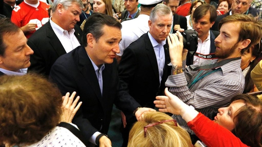 Republican presidential candidate, Sen. Ted Cruz, R-Texas, greets supporters  at the Defending the American Dream summit hosted by Americans for Prosperity, Saturday, Aug. 22, 2015, at the Greater Columbus Convention Center in Columbus, Ohio. (AP Photo/Paul Vernon)