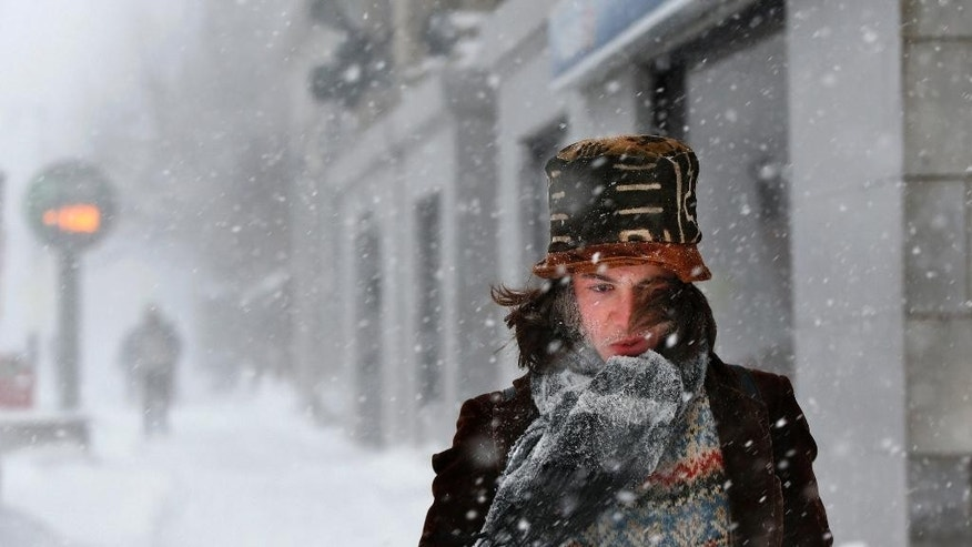 """FILE - In this Feb. 2, 2015 file photo, Dylan Chestnutt endures wind-whipped snow while walking during a winter storm in single digit temperatures in Portland, Maine. The Farmer's Almanac is warning of another rough winter. The editors of the Maine-based publication have dubbed their latest forecast a """"winter deja vu,"""" hearkening to last winter's misery across the Northeast (AP Photo/Robert F. Bukaty, File)"""
