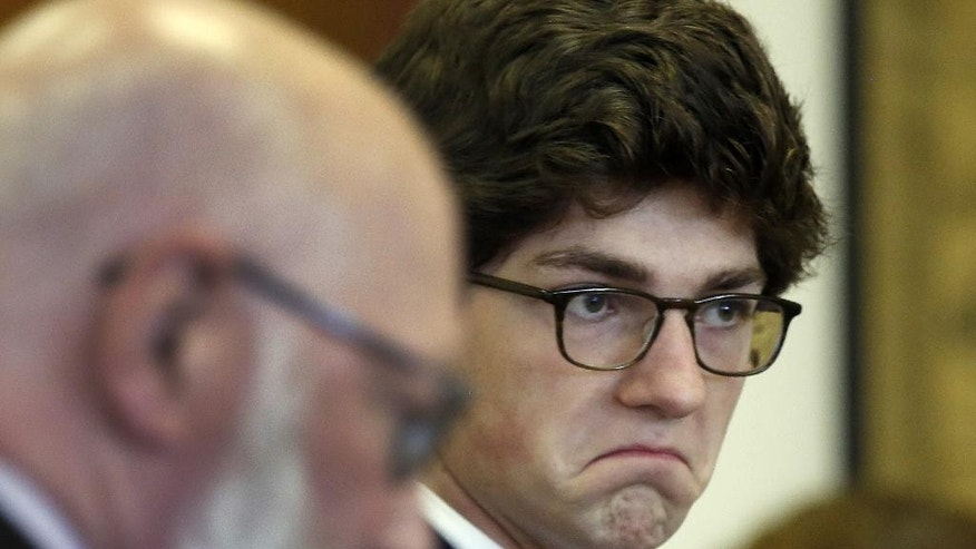 "Owen Labrie leaves the Merrimack County Superior courtroom for the lunch break after several of his classmates testified Monday, Aug. 24, 2015, in Concord, N.H.  Labrie is charged with raping a 15-year-old freshman in 2014 as part of the ""Senior Salute,"" a practice of sexual conquest at the prestigious St. Paul's School in Concord. (AP Photo/Jim Cole, Pool)"
