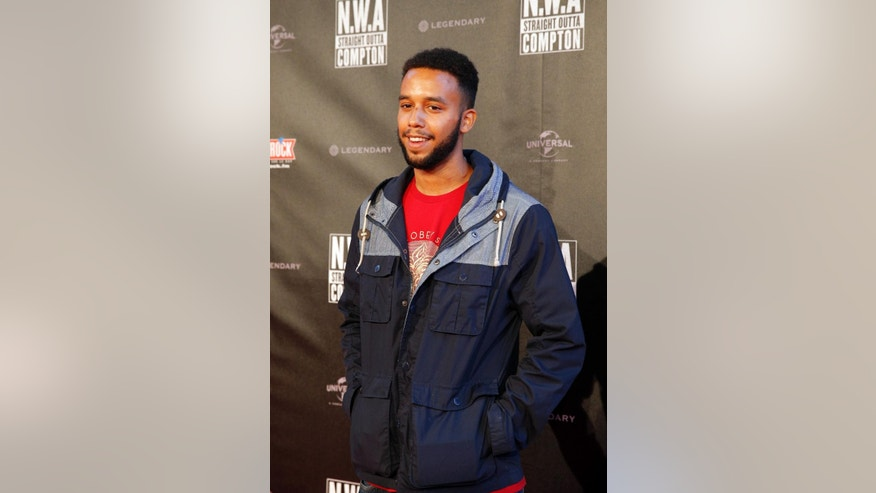 Anthony Sadler, a senior at Sacramento State University in California and one of the three US heroes who subdued the gunman on a French train, poses for the media during the French premiere of  Straight Outta Compton, in Paris, Monday Aug, 24, 2015. (AP Photo/Christophe Ena)