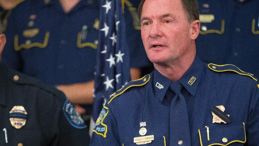 Louisiana State Police Col. Mike Edmonson announces the death of Trooper Steven Vincent, Monday, Aug. 24, 2015 during a news conference at Lake Charles Memorial Hospital in Lake Charles, La. Vincent was shot in the head Sunday night near Bell City during a traffic stop. (Rick Hickman/Lake Charles American Press via AP)