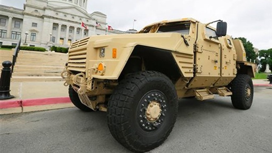 FILE - In this file photo taken May 26, 2015, a prototype of a Lockheed Martin Joint Light Tactical Vehicle is parked in front of the Arkansas state Capitol in Little Rock, Ark. (AP Photo/Danny Johnston, File)