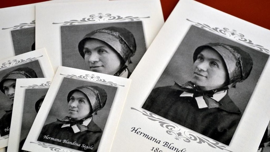 Pamphlets and prayer cards of Sister Blandina Segale sit on a table at the Catholic Center in Albuquerque, N.M. as an Archdiocese of Santa Fe panel listens to evidence about Segale on possible Sainthood on Tuesday, Aug. 25, 2015. The Italian-born nun who challenged Billy the Kid, calmed angry mobs and helped open New Mexico territory hospitals and schools faced her first test for sainthood during the panel's first inquiry. (AP Photo/Russell Contreras)