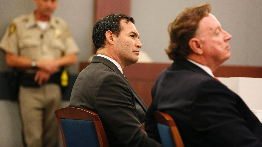 George Tiaffay, center, appears in court with his attorney Robert Langford, right, Tuesday, Aug. 25, 2015, in Las Vegas. Tiaffay is accused of hiring a homeless man to kill his wife Shauna Tiaffay nearly three years ago. (AP Photo/John Locher)