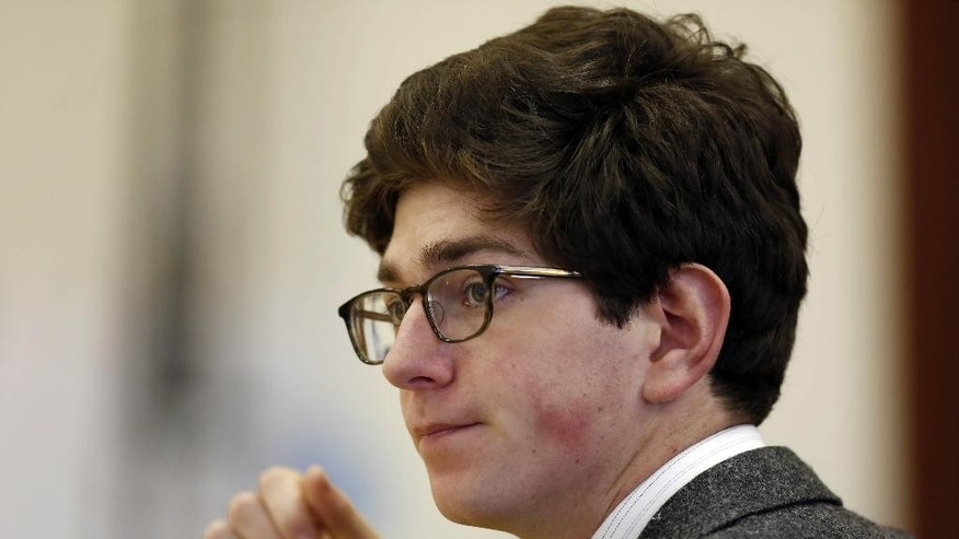 "Owen Labrie listens to testimony in Merrimack County Superior Court Tuesday, Aug. 25, 2015, in Concord, N.H. Labrie is charged with raping a 15-year-old freshman as part of the ""Senior Salute,"" a practice of sexual conquest at the prestigious St. Paul's School in Concord. (AP Photo/Jim Cole, Pool)"