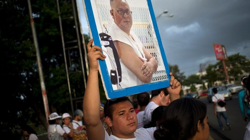 Members of the Nicaraguan Human Rights Center, CENIDH, holds a picture of Nicaraguan Bernardo Aban Tercero during a demonstration against his execution in Managua, Nicaragua, Monday, Aug. 24, 2015.  Tercero, whose age was in dispute during the trial, was sentenced to death in October 2000 in connection with the March 1997 fatal shooting of Robert Berger, 38, a Reagan High School English teacher.  The execution is scheduled for next Wednesday Aug. 26 in Huntsville, Texas. (AP Photo/Esteban Felix)