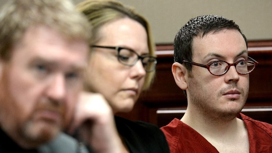 Defense attorneys Daniel King, left, and Katherine Spengler, sits at a table with James Holmes, right, as he appears in court for the sentencing phase of his trial Tuesday, Aug. 25, 2015, at Arapahoe County District Court in Centennial, Colo. Victims and their families were given the opportunity to speak about the shooting and its effects on their lives. Holmes was convicted Aug. 7 of murdering 12 people when he opened fire on a crowded movie theater in 2012. (RJ Sangosti/The Denver Post via AP, Pool)