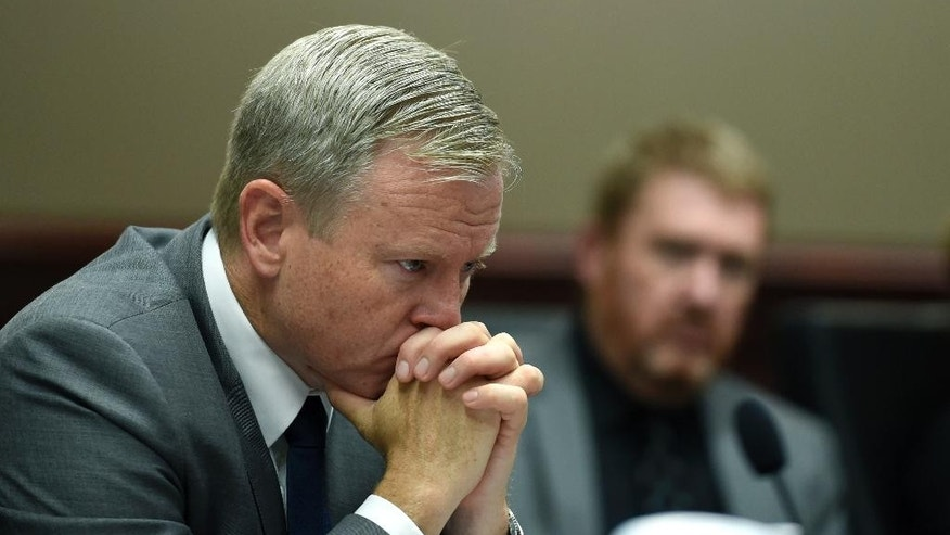 District Attorney George Brauchler, left, and defense attorney Daniel King, listen to victim statements being read in court during the sentencing phase in James Holmes' trial, Tuesday, Aug. 25, 2015, at Arapahoe County District Court in Centennial, Colo. Victims and their families were given the opportunity to speak about the shooting and its effects on their lives. Holmes was convicted Aug. 7 of murdering 12 people when he opened fire on a crowded movie theater in 2012. (RJ Sangosti/The Denver Post via AP, Pool)