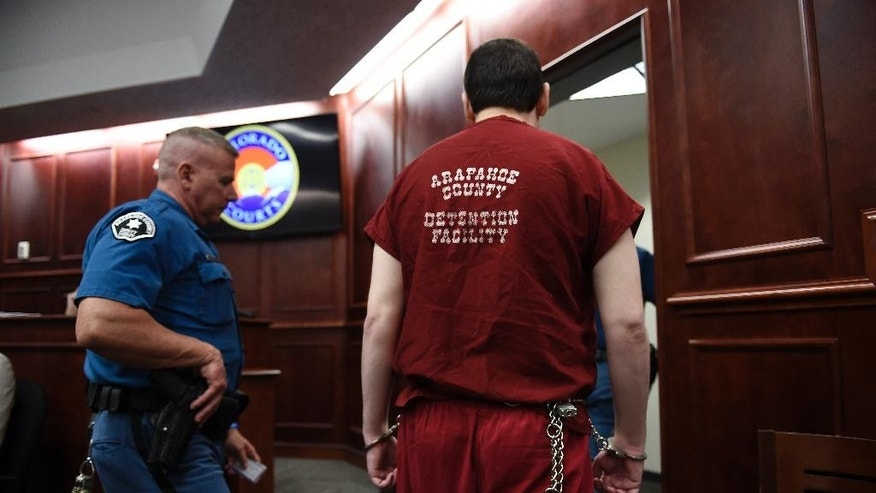 Colorado theater shooter James Holmes is led out of the courtroom after being formally sentenced on Wednesday, Aug. 26, 2015 in Centennial, Colo.  Holmes was sentenced to life in prison without parole by Judge Carlos Samour Jr.  Holmes killed 12 people and injured 70 others in the July 20, 2012 ambush.  (RJ Sangosti/The Denver Post via AP, Pool)