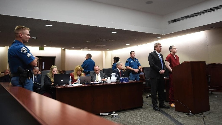 Colorado theater shooter James Holmes appears in court, with his attorney Daniel King, to be formally sentenced as the prosecution team looks on, Wednesday, Aug. 26, 2015 in Centennial, Colo.  Holmes was sentenced to life in prison without parole by Judge Carlos Samour Jr.  Holmes killed 12 people and injured 70 others in the July 20, 2012 ambush.  (RJ Sangosti/The Denver Post via AP, Pool)