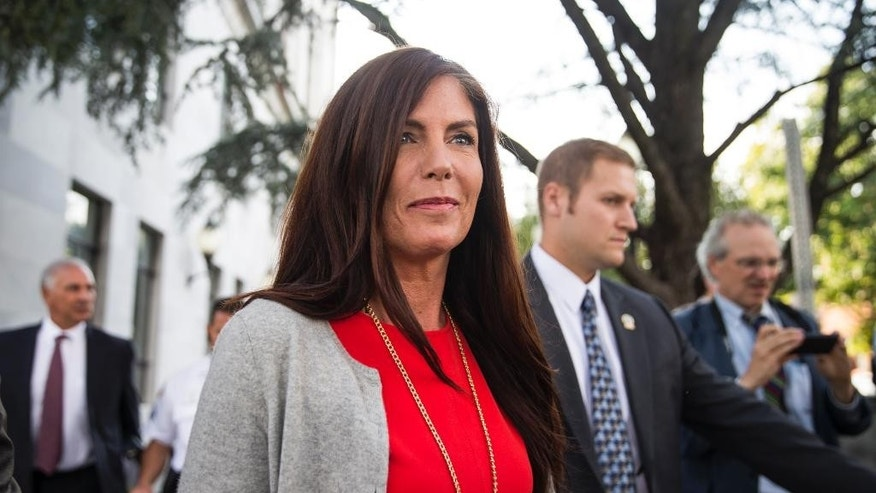 Pennsylvania Attorney General Kathleen Kane departs after her preliminary hearing Monday, Aug. 24, 2015, at the Montgomery County courthouse in Norristown, Pa. Kane is accused of leaking secret grand jury information to the press, lying under oath and ordering aides to illegally snoop through computer files to keep tabs on an investigation into the leak. (Christopher Dolan/The Times & Tribune via AP) WILKES BARRE TIMES-LEADER OUT; MANDATORY CREDIT