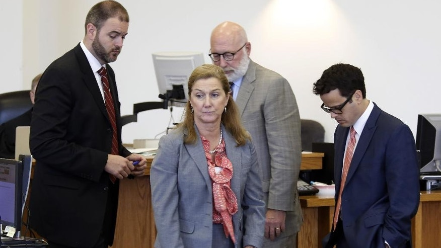 Prosecutors Catherine Ruffle, center, and Joseph Cherniske, left, leave the judges bench with defense lawyers Sam Zaganjori, right, and J.W. Carney in Merrimack County Superior Court during the rape trial of former St. Paul's School student Owen Labrie Tuesday, Aug. 25, 2015, in Concord, N.H. The prosecution announced it had closed its case. Labrie is charged with raping a 15-year-old freshman as part of the Senior Salute, a practice of sexual conquest at the prestigious St. Paul's School in Concord. (AP Photo/Jim Cole, Pool)