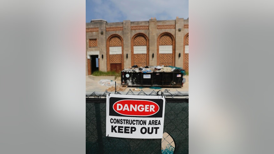 In this Aug. 10, 2015, photo, a construction sign is seen outside the Dunes State Park pavilion in Chesterton, Ind. A deal with investors to privatize and refurbish the pavilion, an aging-yet-iconic structure with sweeping views of Lake Michigan, is raising questions about the privatization of public resources. (AP Photo/Christian K. Lee)