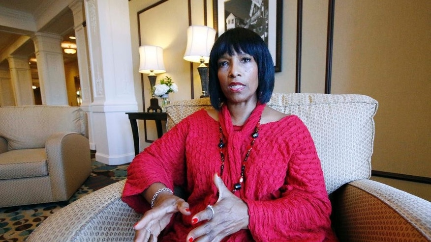 Deborah Watts of Minneapolis, sits in a Jackson, Miss., hotel Thursday, Aug. 27, 2015, and speaks about events in Mississippi and Illinois this week that commemorate the 60th anniversary of the slaying of her cousin, Emmett Till, a black 14-year-old from Chicago, who was visiting relatives in the Mississippi Delta when witnesses said he violated the Jim Crow social code by whistling at a white woman. He was kidnapped and killed Aug. 28, 1955, and his body was recovered from the Tallahatchie River three days later. An all-white jury acquitted two white men charged in the slaying. (AP Photo/Rogelio V. Solis)