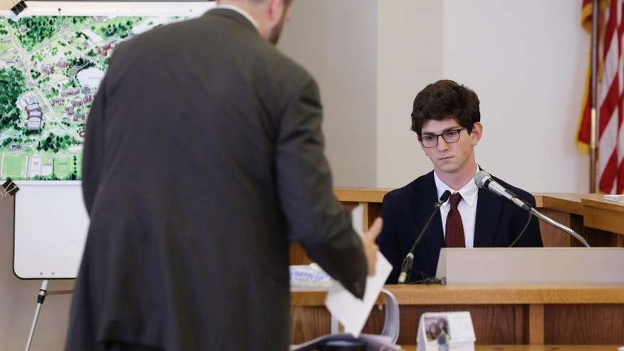 Former St. Paul's School student Owen Labrie watches as prosecutor Joseph Cherniske, left, introduces evidence during Labrie's trial at Merrimack Superior Court in Concord, N.H., Wednesday, Aug. 26, 2015. Labrie is charged with raping a 15-year-old freshman as part of Senior Salute, in which seniors try to romance and have intercourse with underclassmen before leaving the prestigious St. Paul's School in Concord. The defense contends the two had consensual sexual contact but not intercourse. (AP Photo/Charles Krupa, Pool)