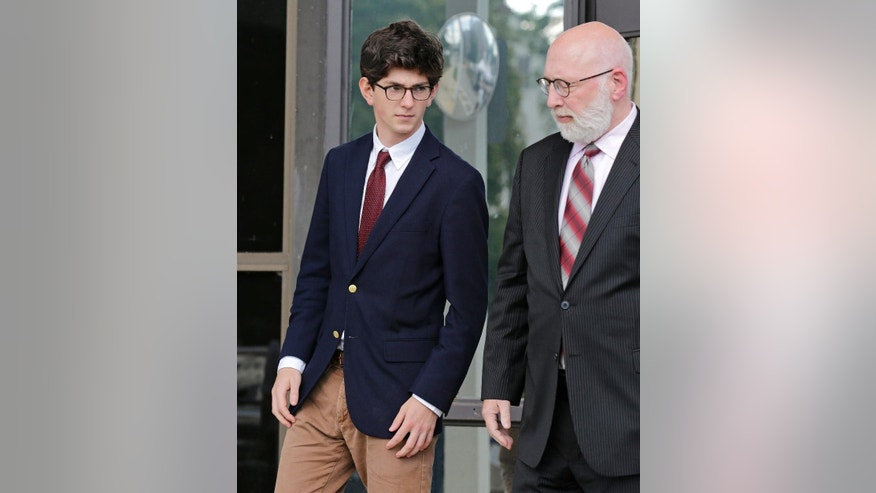 Former St. Paul's School student Owen Labrie leavers court with his attorney J.W. Carney at Merrimack Superior Court in Concord, N.H., Wednesday, Aug. 26, 2015.Labrie is charged with raping a 15-year-old freshman as part of Senior Salute, in which seniors try to romance and have intercourse with underclassmen before leaving the prestigious St. Paul's School in Concord. The defense contends the two had consensual sexual contact but not intercourse. (AP Photo/Charles Krupa, Pool)