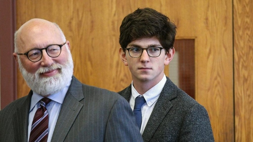 Looking in the direction of the victim's family, former St. Paul's School student Owen Labrie, right, enters the courtroom with his defense attorney J.W. Carney for closing remarks in Labrie's rape trial at Merrimack Superior Court Thursday, Aug. 27, 2015, in Concord, N.H. Labrie is charged with raping a 15-year-old freshman as part of Senior Salute, in which seniors try to romance and have intercourse with underclassmen before leaving the prestigious St. Paul's School in Concord. The defense contends the two had consensual sexual contact but not intercourse. (AP Photo/Cheryl Senter, Pool)