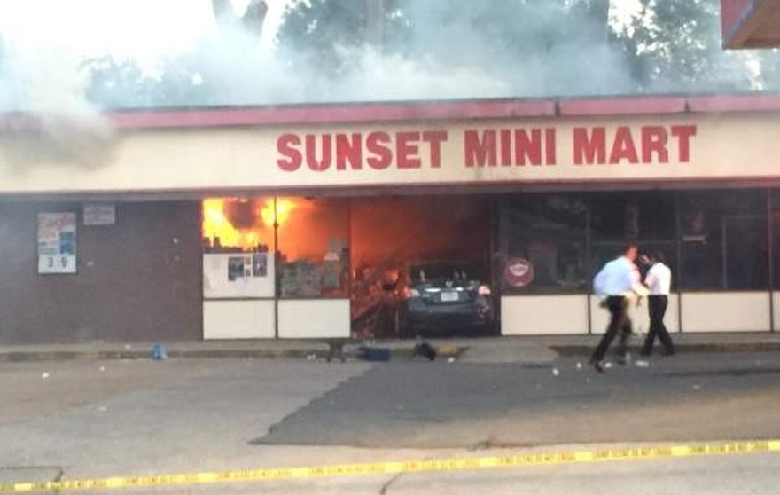 Aug. 26, 2015: The mini where a suspect involved in a fatal police shooting was apprehended catches fire.