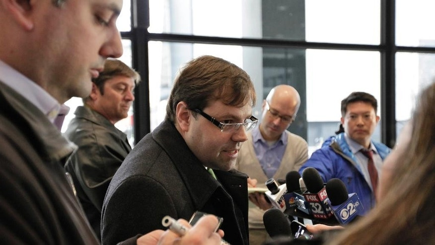 FILE - In this Dec. 21, 2012 file photo, attorney Beau Brindley, center, speaks with reporters at the federal courthouse in Chicago. Closing arguments were planned for Thursday, Aug. 27, in the federal bench trial of Brindley, who is facing obstruction-of-justice charges. (AP Photo/Teresa Crawford, File)