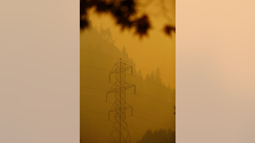 Heavy smoke drapes over Seattle City Light facilities in Newhalem, Wash., Wednesday, Aug. 26, 2015. Smoky conditions grounded helicopters and airplanes Wednesday that had been fighting the fires. (Mark Mulligan/The Herald via AP) MANDATORY CREDIT
