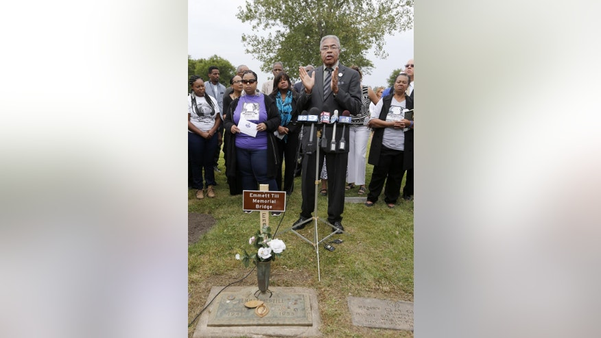 Rev. Wheeler Parker, Jr., Emmett Till's cousin and eyewitness to Till's kidnapping, addresses the crowd gathered at a gravesite ceremony at the Burr Oak Cemetery marking the 60th anniversary of the murder of Till in Mississippi, Friday, Aug. 28, 2015, in Alsip, Ill. (AP Photo/Charles Rex Arbogast)