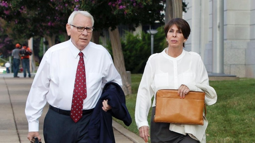 Former Arkansas Treasurer Martha Shoffner, right, and her attorney Chuck Banks walk to federal court in Little Rock, Ark., for Shoffner's sentencing Friday, Aug. 28, 2015, on multiple counts of extortion and bribery. (AP Photo/Danny Johnston)