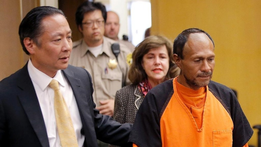 FILE - In this July 7, 2015 file photo, Juan Francisco Lopez-Sanchez, right, is lead into the courtroom by San Francisco Public Defender Jeff Adachi, left, and Assistant District Attorney Diana Garciaor, center, for his arraignment at the Hall of Justice in San Francisco. Even if the suspect at the center of a national immigration debate accidentally fired the shot that killed Kate Steinle on San Francisco's Pier 14, on July 1, it may not help his case. (Michael Macor/San Francisco Chronicle via AP, Pool, File)