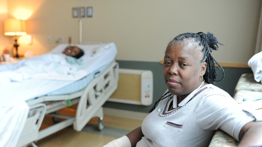 Chevelle Washington, right, sits in the hospital room of her sister, Chelette Price, in Houston on Thursday, Aug. 13, 2015. One profound change wrought by Hurricane Katrina was the splitting of families as a mass evacuation from chaotic New Orleans sent thousands, including Washington's family, to the safety of other cities. (AP Photo/Pat Sullivan)