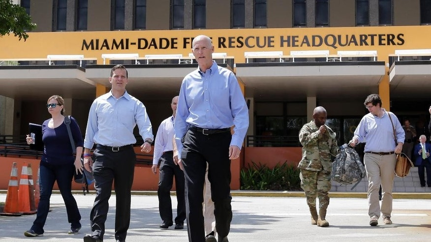 "Florida Gov. Rick Scott, center, and Lt. Gov. Carlos Lopez-Cantera, left, head to the podium to talk to reporters at the Miami-Dade State Emergency Operations Center, Friday, Aug. 28, 2015, in Doral, Fla. Scott said that Tropical Storm Erika poses a ""severe threat to the entire state"" and declared a state of emergency. Scott made his declaration shortly after forecasters adjusted the trajectory of the storm to show that it's predicted to strike the southern tip of the state and then traverse northward. (AP Photo/Alan Diaz)"