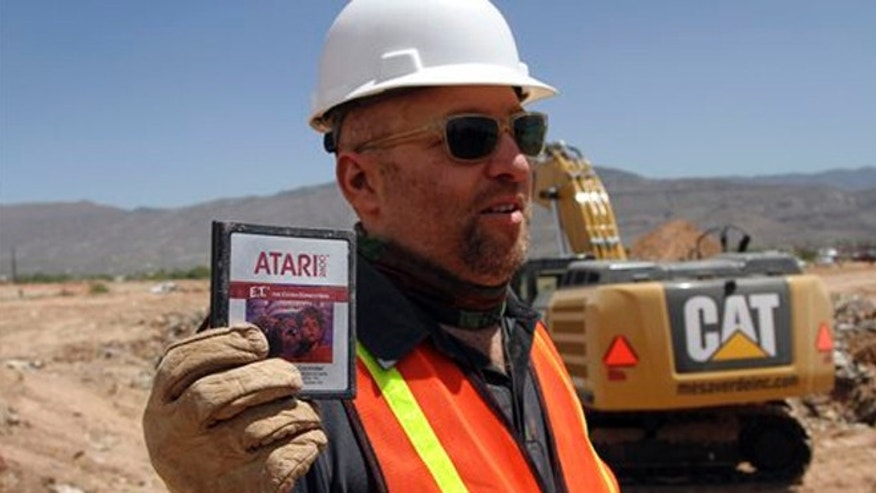 "April 26, 2014: In this file photo, film director Zak Penn shows a box of a decades-old Atari ""E.T. the Extra-Terrestrial"" game found in a dumpsite in Alamogordo, N.M."