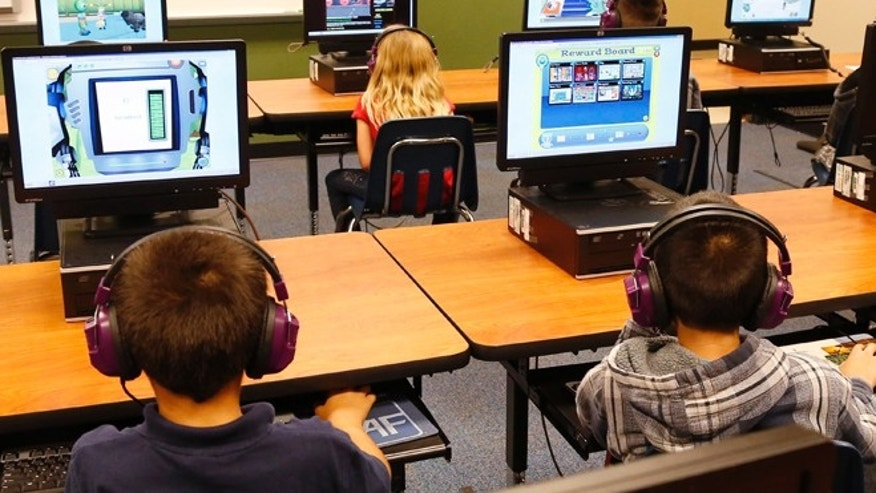 July 21, 2014: Students at a summer reading academy at Buchanan elementary school work in the computer lab at the school in Oklahoma City. Results for some of the states that participated in Common Core-aligned testing for the first time this spring are out, with overall scores higher than expected though still below what many parents may be accustomed to seeing.