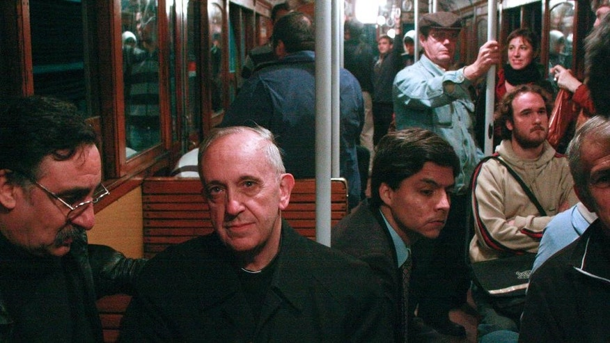 FILE - In this 2008 file photo, Argentina's Cardinal Jorge Mario Bergoglio, second from left, rides the subway in Buenos Aires, Argentina. Bergoglio, who became pope in 2013 and took the name Francis, was known for taking the train. Cardinal Bergoglio never followed the footsteps of so many fellow Roman Catholic leaders of his rank, who sought to raise their profiles, along with funds for missions back home, by networking within the deeply influential and well-resourced U.S. church. (AP Photo/Pablo Leguizamon, File)
