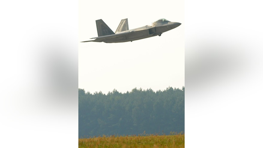 U.S. stealthy high-tech F-22 Raptor fighter jet flies above the military base in Lask, Poland, Monday, Aug. 31, 2015.  Two Raptors came to Lask as a part of the inaugural F-22 training deployment to Europe. (AP Photo/Alik Keplicz)