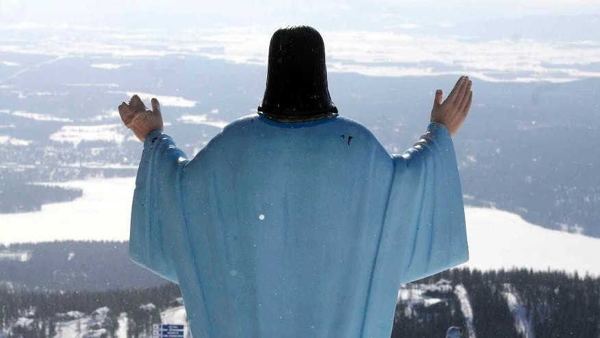 FILE - In this Feb. 20, 2011 file photo, the statue of Jesus Christ at Whitefish Mountain Resort overlooks Whitefish Lake and the Flathead Valley in Whitefish, Mont.   A federal appeals court ruled Monday, Aug. 31, 2015, that the 6-foot tall statue of Jesus that has spent the last 60 years overlooking a northwestern Montana ski hill may stay there. The 9th U.S. Circuit Court of Appeals rejects arguments from a group of atheists and agnostics that placing the statue on U.S. Forest Service land violates the separation of church and state. (Linda Thompson/The Missoulian via AP) MANDATORY CREDIT