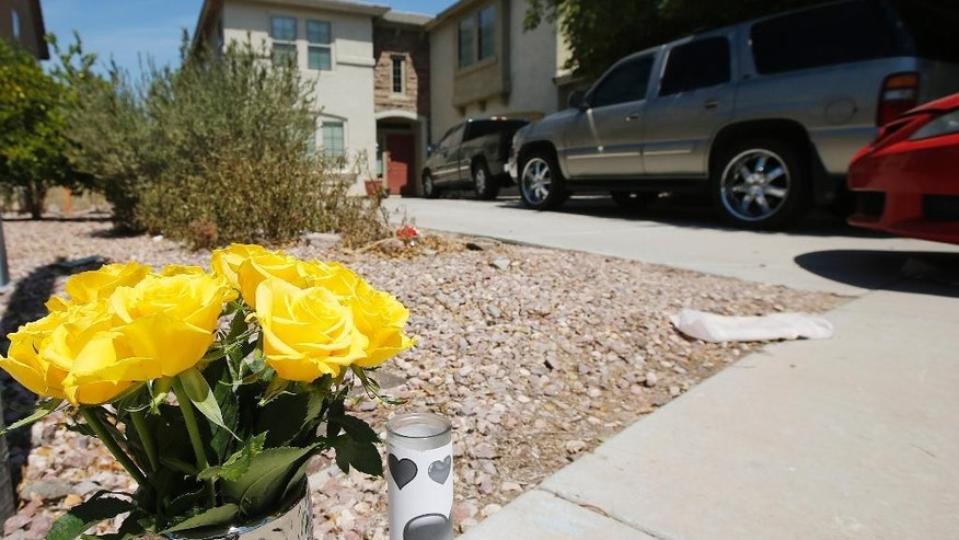 A makeshift memorial sits in front of the home where twin boys were alleged murdered by their mother Mireya Alejandra Lopez, Monday, Aug. 31, 2015, in Avondale, Ariz. Lopez told investigators that she drowned her 2-year-old twin sons and tried to kill her 3-year-old stepbrother in the same way because she didn't want them to live with the difficulties she faces. Lopez was arrested on suspicion of first-degree murder and attempted first-degree murder. Her bail was set at $2 million. (AP Photo/Ross D. Franklin)