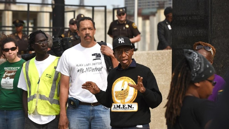 In this Friday, Aug. 28, 2015 photo, Ron Scott, center, of the Detroit Coalition Against Police Brutality, voices his concerns during a rally outside the Frank Murphy Hall of Justice in Detroit regarding the shooting death of Terrance Kellom by an U.S. Immigration and Customs Enforcement (ICE) officer in April 2015. As the Black Lives Matter movement gains more public attention, there are questions being raised about who's in charge of the movement and what its long-term goals are. (Max Ortiz/The Detroit News via AP)